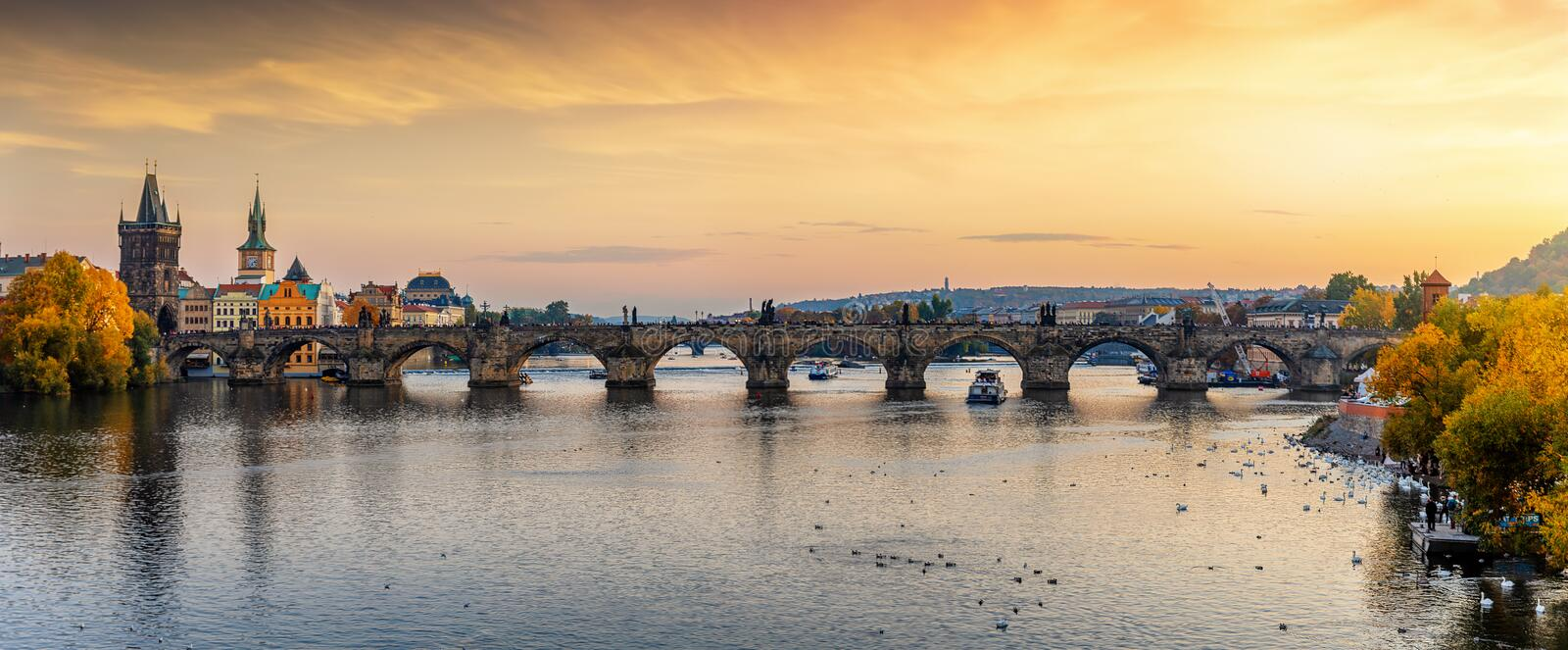 Panoramic view to the famous Charles Bridge over the river Vltava in Prague during sunset time royalty free stock photo