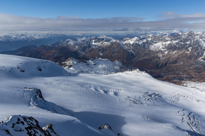 Panoramic view to Italian Alps from matterhorn glacier paradise to Alps, Switzerland. Amazing Panoramic view to Italian Alps from matterhorn glacier paradise to royalty free stock photos