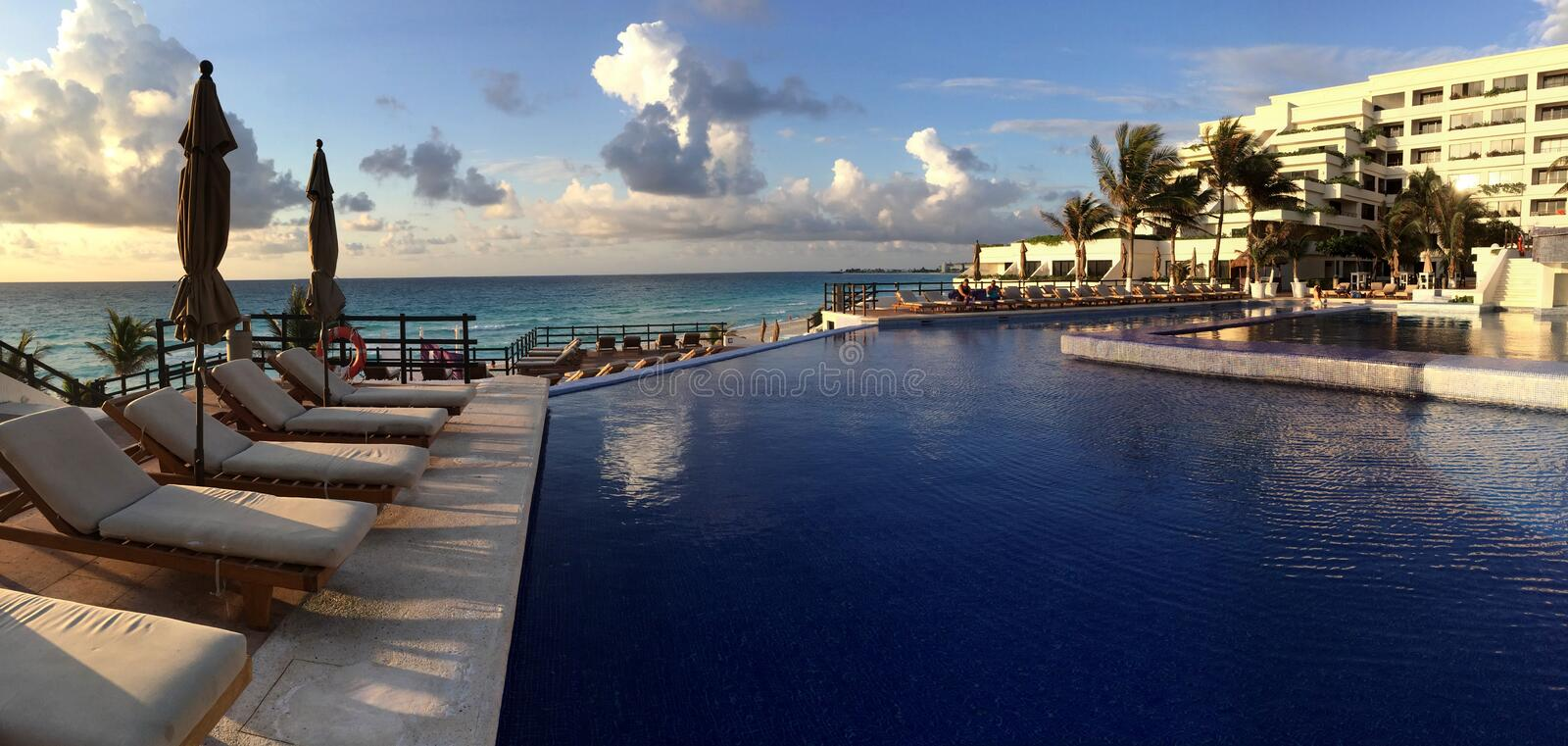 Panoramic view to the swimming pool in the resort at sunrise tim. E in Cancun, Mexico royalty free stock images