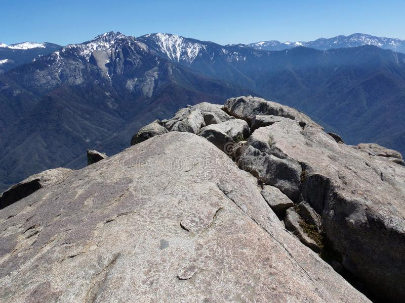 Standing at the edge of Moro Rock overlooking snowy mountains and valleys - Sequoia National Park stock photo