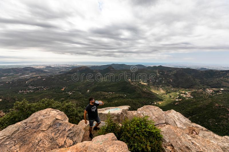 Panoramic View Of Tourist On Mountain Peak stock photos