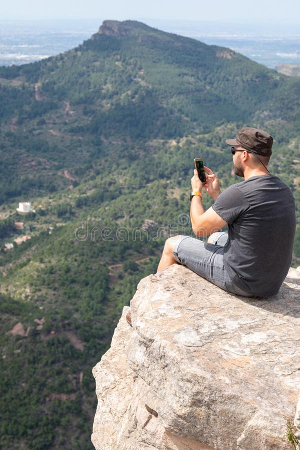 Panoramic View Of Tourist On Mountain Peak royalty free stock photos