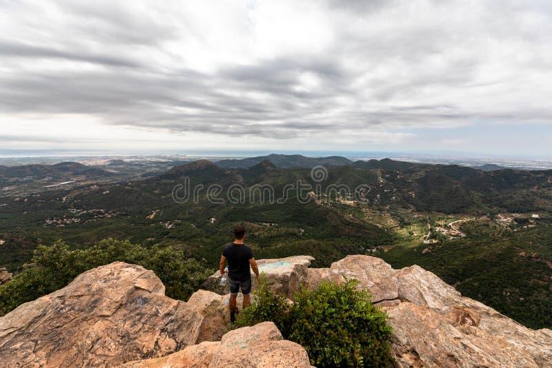 Panoramic View Of Tourist On Mountain Peak stock image