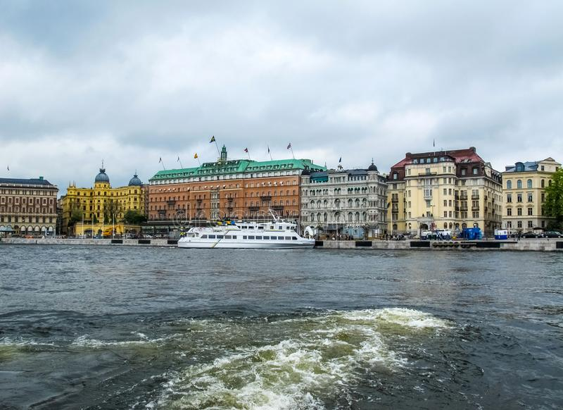Panoramic view from the tourist boat to the beautiful buildings of Stromkajen in the center of Stockholm Sweden stock photography
