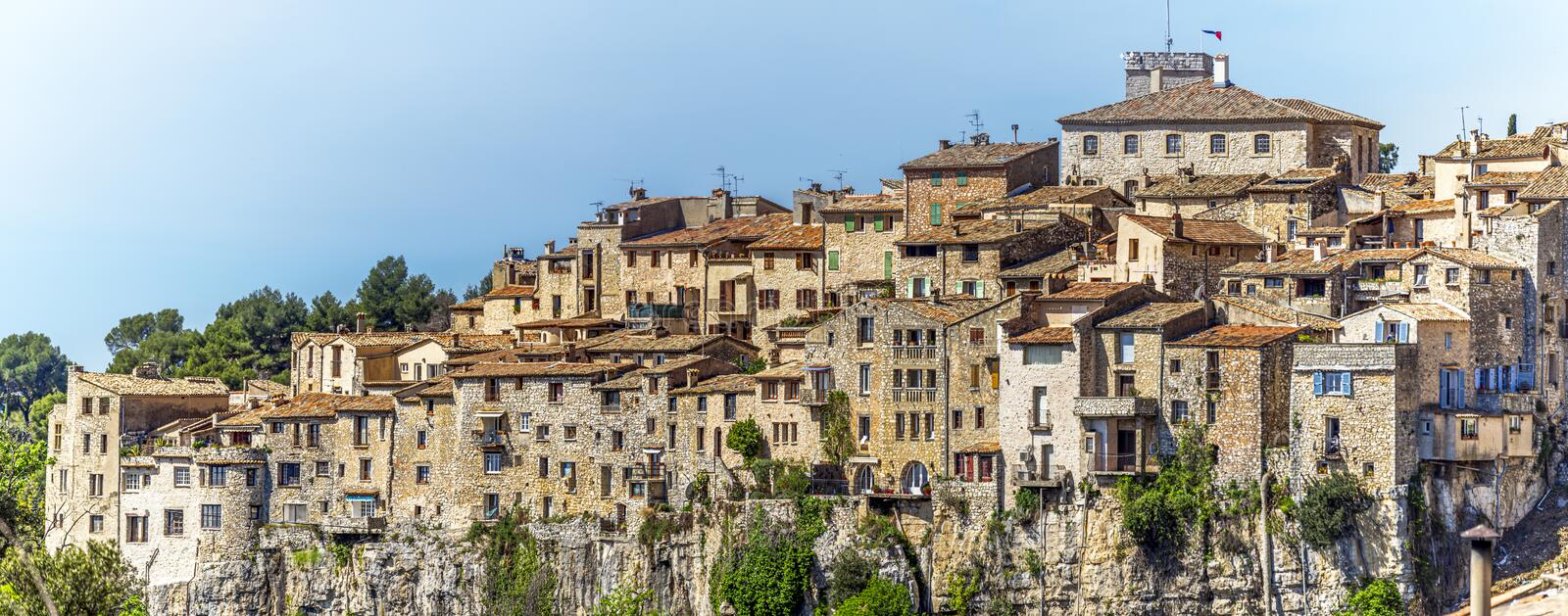 Panoramic view of Tourrettes-sur-Loup medieval village from Cassan Valley. Southeastern France, Alpes Maritimes.  stock photos