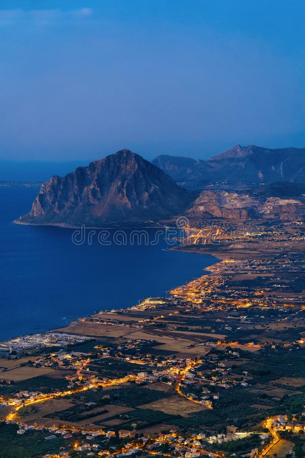 Panoramic view towards Monte Cofano at Erice Sicily Italy. Panoramic view towards Monte Cofano seen in Erice, Sicily island, in Italy. At sunset. San Vito lo stock image