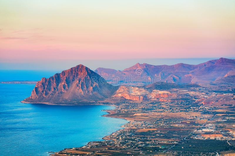 Panoramic view towards Monte Cofano in Erice Sicily. Panoramic view towards Monte Cofano seen from Erice, Sicily island, Italy. At sunset. San Vito lo Capo on royalty free stock image