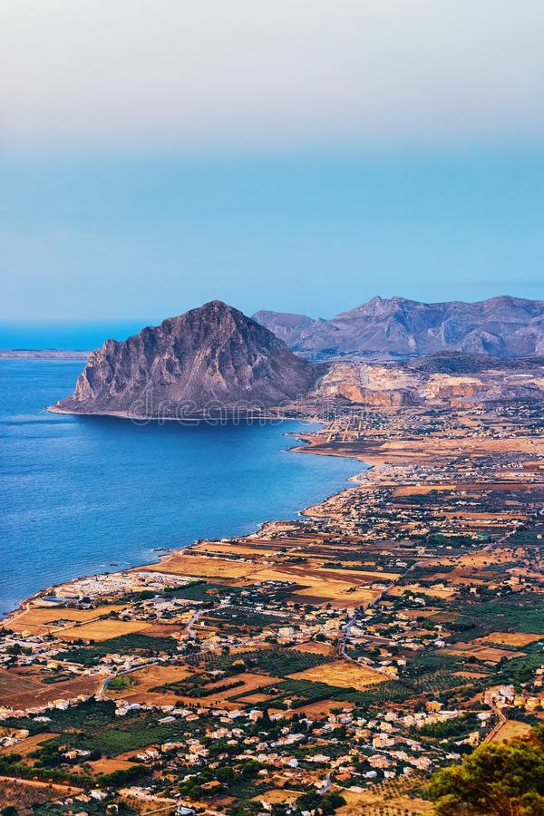 Panoramic view towards Monte Cofano in Erice Sicily Italy. Panoramic view towards Monte Cofano seen from Erice, Sicily island, in Italy. At sunset. San Vito lo stock images