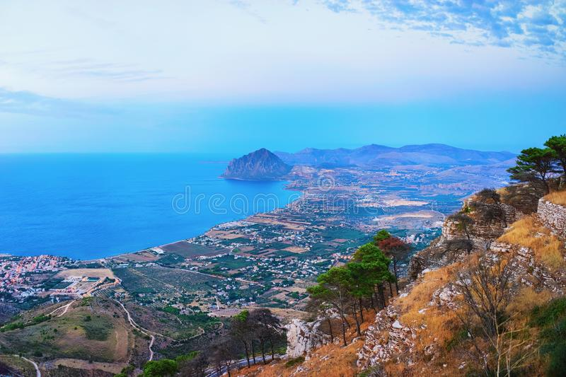 Panoramic view towards Monte Cofano at Erice Sicily. Panoramic view towards Monte Cofano seen in Erice, Sicily island, Italy. At sunset. San Vito lo Capo on the stock photos