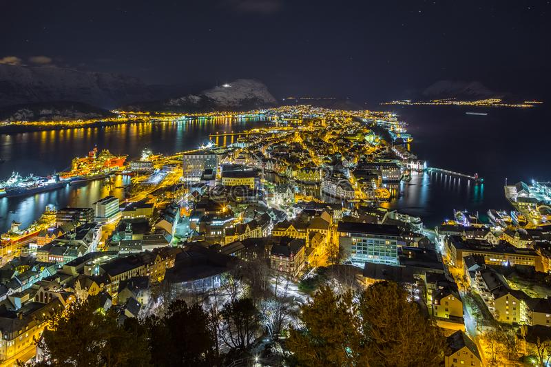 Panoramic view of the town of Alesund by night from Aksla hill. stock photos