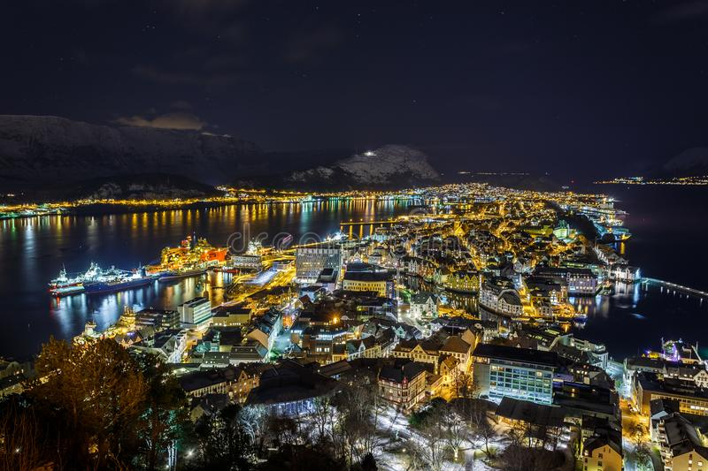 Panoramic view of the town of Alesund by night from Aksla hill. stock images