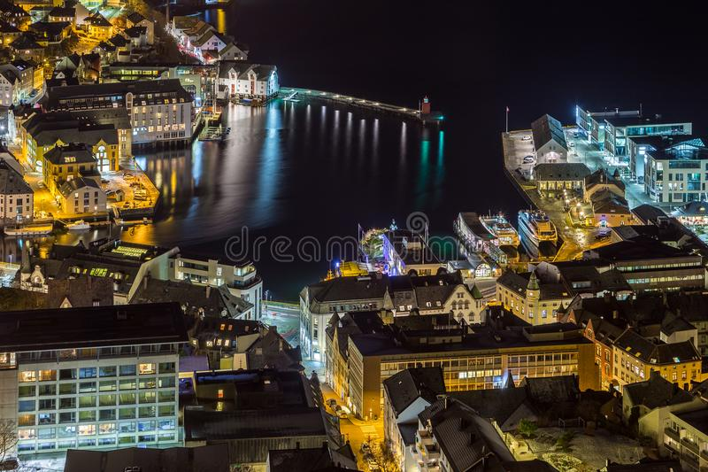 Panoramic view of the town of Alesund by night from Aksla hill. royalty free stock images
