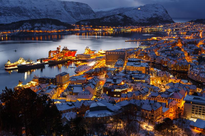 Panoramic view of the town of Alesund at sunset from Aksla hill. stock photos