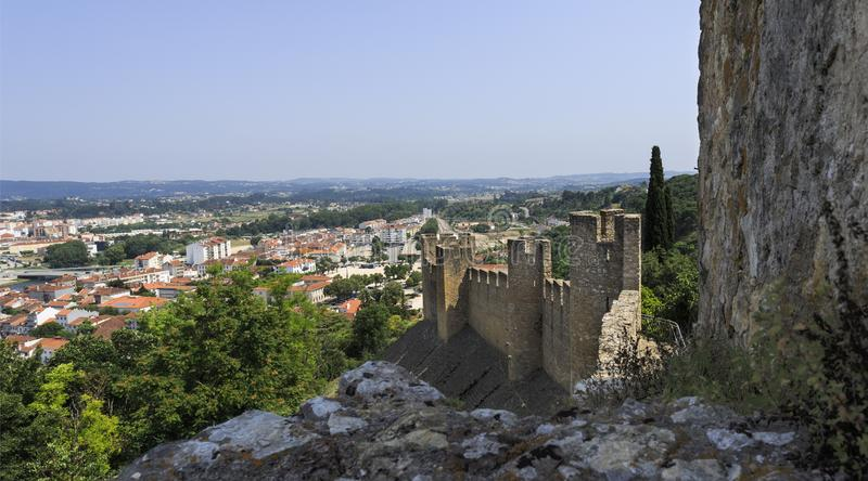 Town of Tomar seen from the Templars Castle. Panoramic view of the town of Tomar, in Portugal, seen from the Castle of the Templar Kights royalty free stock image