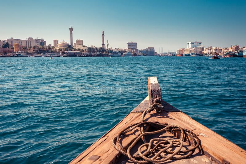 Panoramic view from traditional water taxi boats in Dubai, UAE. Creek gulf and Deira area. United Arab Emirates famous tourist. Destination. Creative color post royalty free stock photos