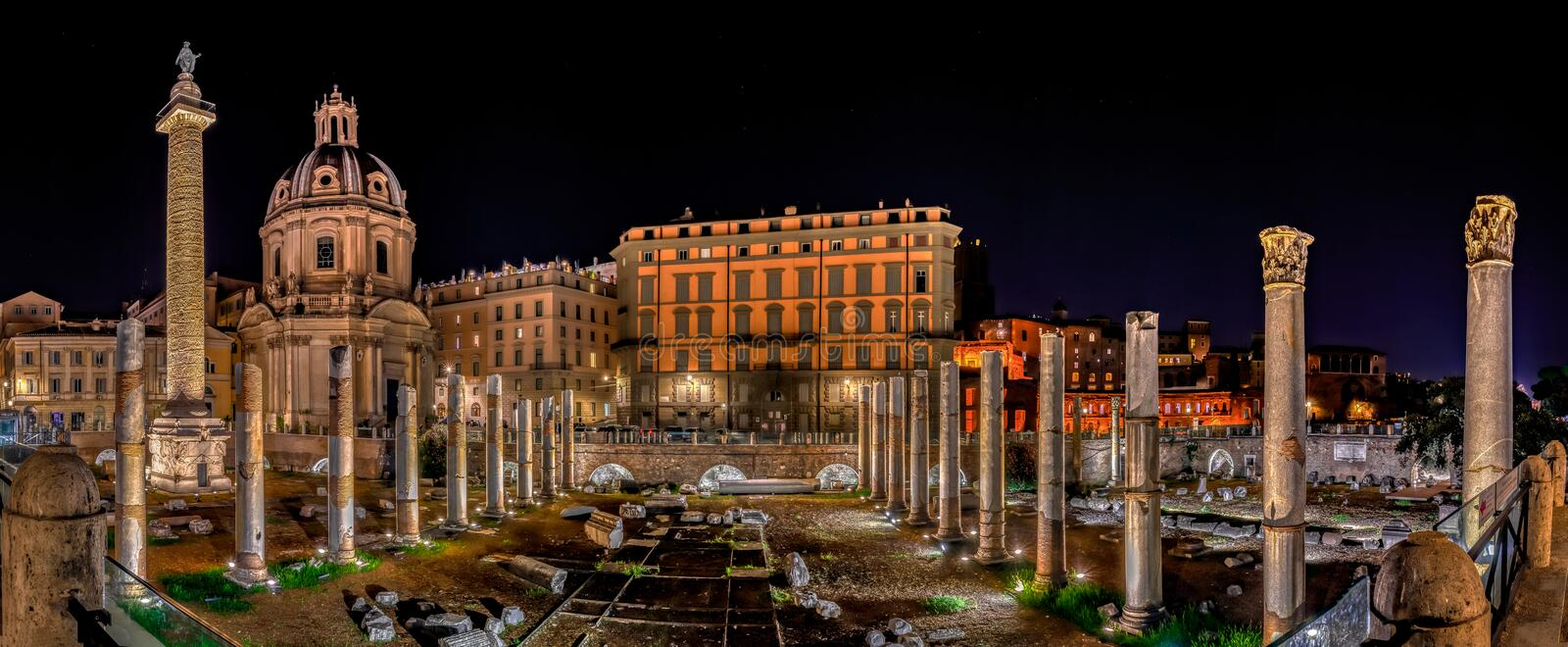 Panoramic view of Trajan forum at night in Rome, Italy stock image