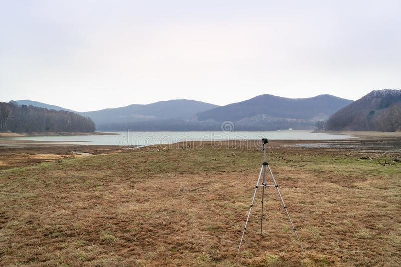 Panoramic view and tripod stock photography