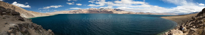 Panoramic view of Tso Moriri lake. Korzok village and mounts Chamser Kangri and Lungser Kangri - Rupshu valley - Ladakh - India - The lake is at an altitude of royalty free stock images