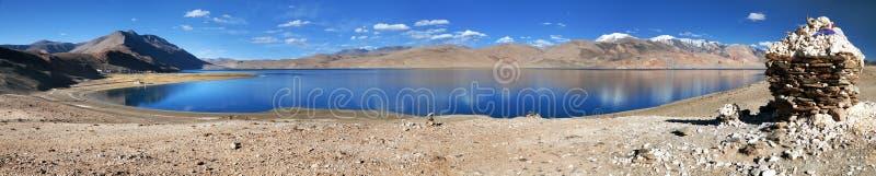 Panoramic view of Tso Moriri lake. Korzok village and mounts Chamser Kangri and Lungser Kangri - Rupshu valley - Ladakh - India - The lake is at an altitude of royalty free stock photography