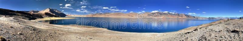 Panoramic view of Tso Moriri lake. Korzok village and mounts Chamser Kangri and Lungser Kangri - Rupshu valley - Ladakh - India - The lake is at an altitude of stock image