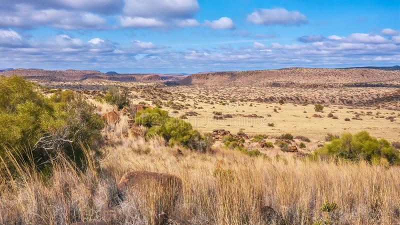The unique landscape of the Great Karoo region in South Africa. A panoramic view of a typical landscape in the Great Karoo region in South Africa, including its stock photography
