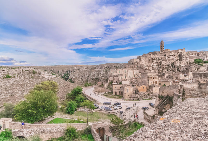 Panoramic view of typical stones (Sassi di Matera) and church of Matera under blue sky. Artistic style. Matera in Italy UNESCO European Capital of Culture 2019 royalty free stock photos
