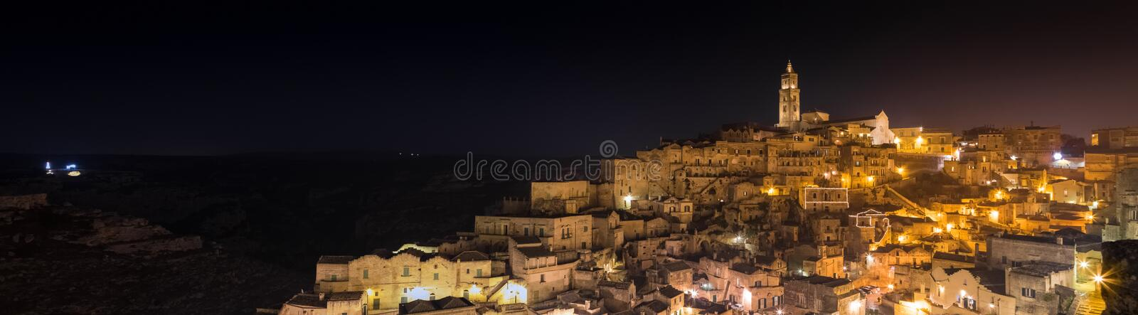 Panoramic view of typical stones (Sassi di Matera) and church of Matera UNESCO European Capital of Culture 2019. At night stock image