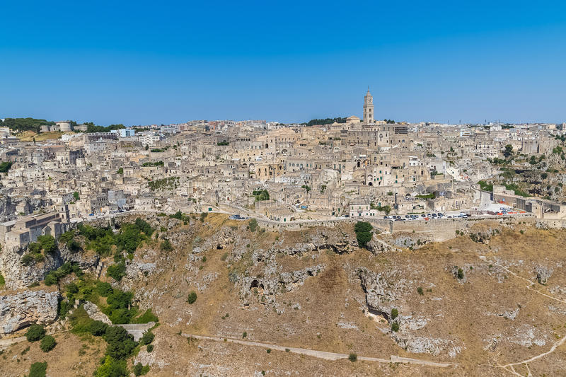 Panoramic view of typical stones Sassi di Matera and church of Matera UNESCO European Capital of Culture 2019 under blue sky. Ba. Silicata, Italy stock photos