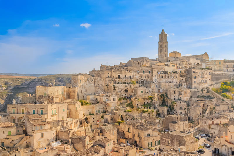 Panoramic view of typical stones (Sassi di Matera) and church of Matera UNESCO. European Capital of Culture 2019 under blue sky. Basilicata, Italy royalty free stock image