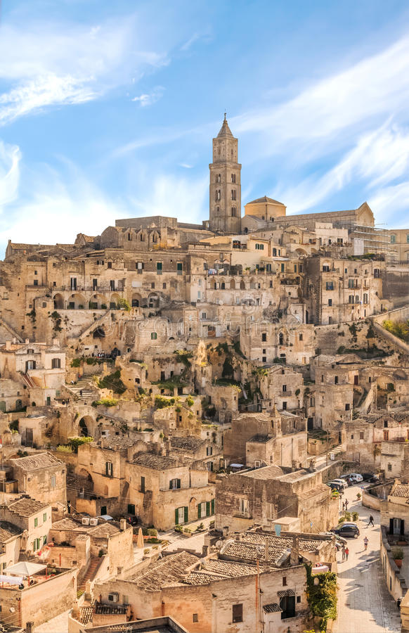 Panoramic view of typical stones (Sassi di Matera) and church of Matera UNESCO European Capital of Culture 2019 under blue sky. Basilicata, Italy royalty free stock photography