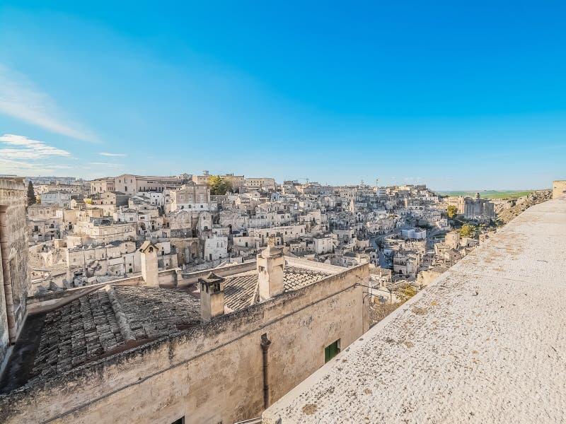 Panoramic view of typical stones Sassi di Matera near gravina of Matera UNESCO European Capital of Culture 2019 on blue sky. Basilicata, Italy stock photos