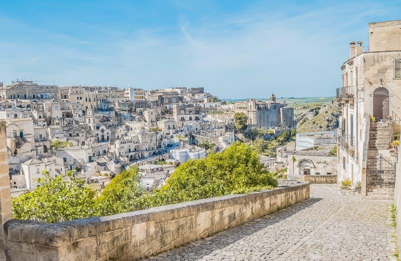 Panoramic view of typical stones Sassi di Matera near gravina of Matera UNESCO European Capital of Culture 2019 on blue sky. Basilicata, Italy stock photography