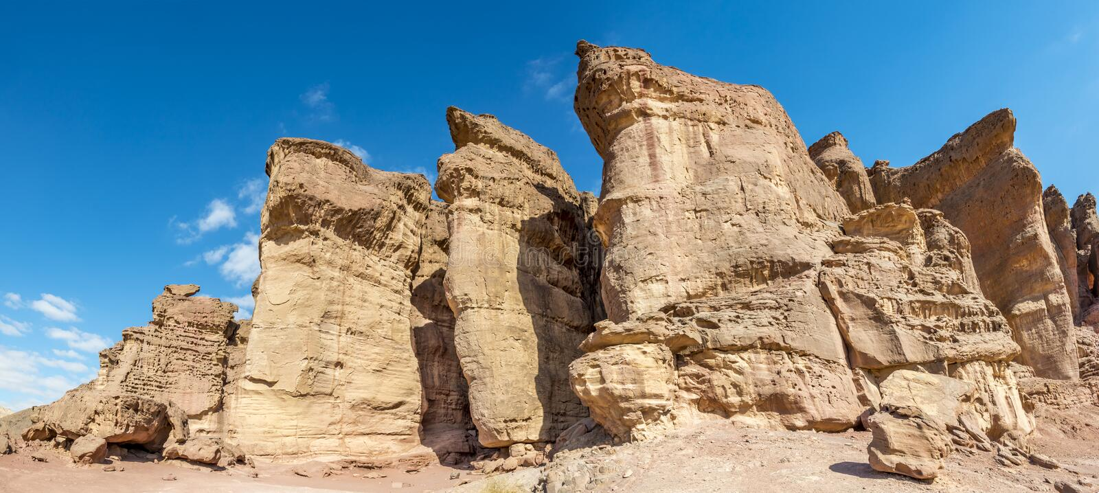 Panoramic view on unique stone formation - pillars of the Solomon King in Timna geological park royalty free stock photography