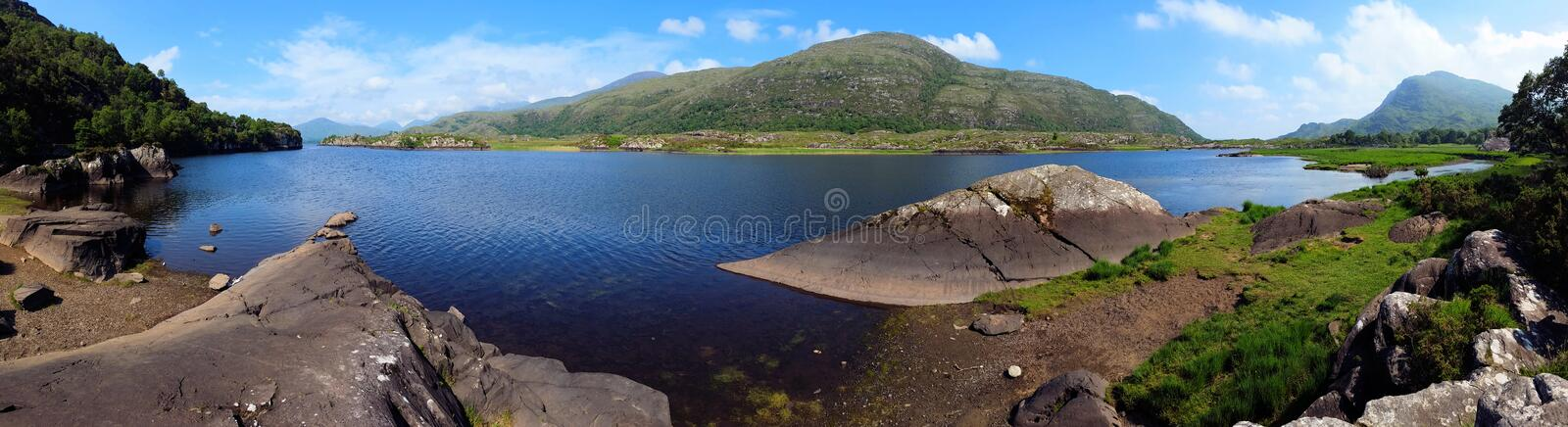 Panoramic view of lakes and mountains of Killarney National Park, Ring of Kerry, Ireland. Panoramic view of Upper Lake and mountains of Killarney National Park royalty free stock images