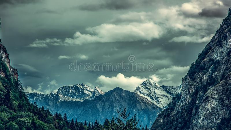 Panoramic view from valley at mountains in the background. royalty free stock images