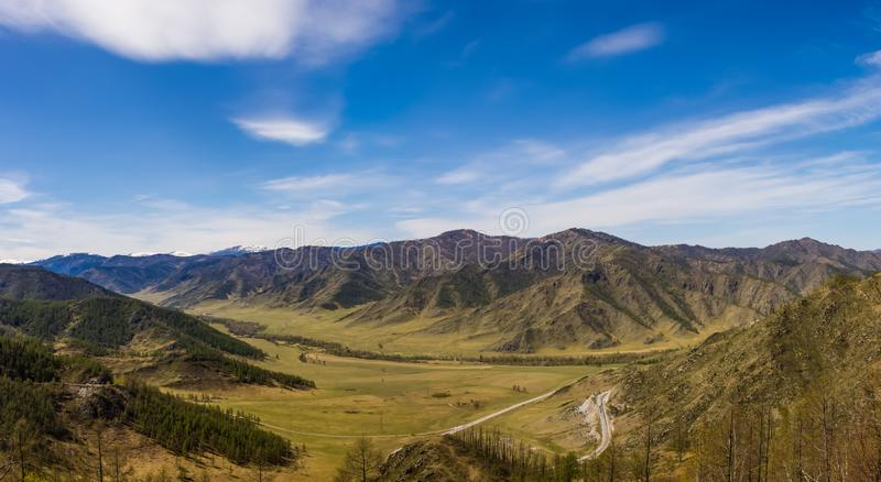 Panoramic view of the valley and mountains from the Chike Taman Pass, Altai, Russia royalty free stock photo