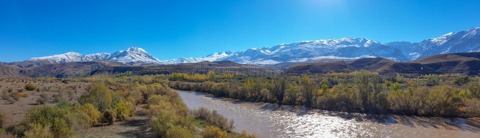 Panoramic view of a valley with snow capped mountains and River Euphrates near Erzincan, Turkey royalty free stock photography