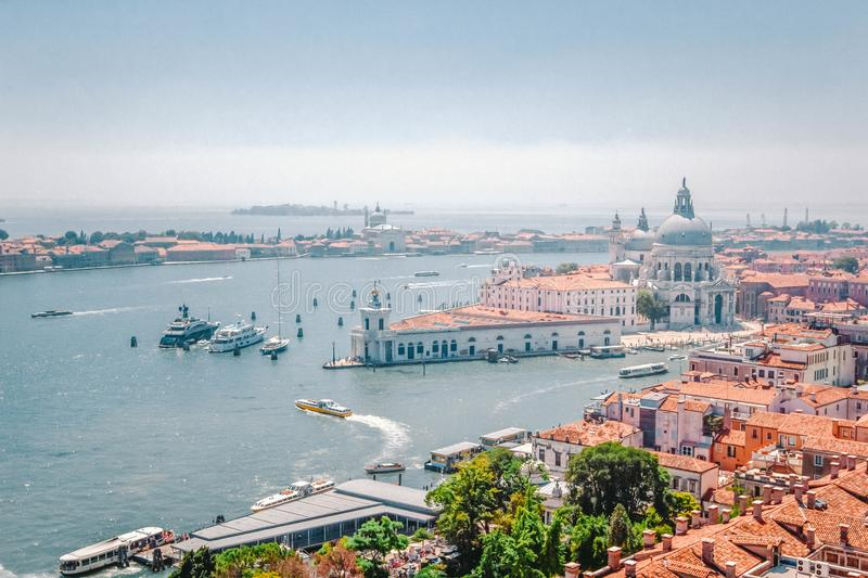 Panoramic view of Venice - Grand Canal with gondolas, Basilica Santa Maria della Salute and red tiled roofs of houses, Venice, Ita royalty free stock photo
