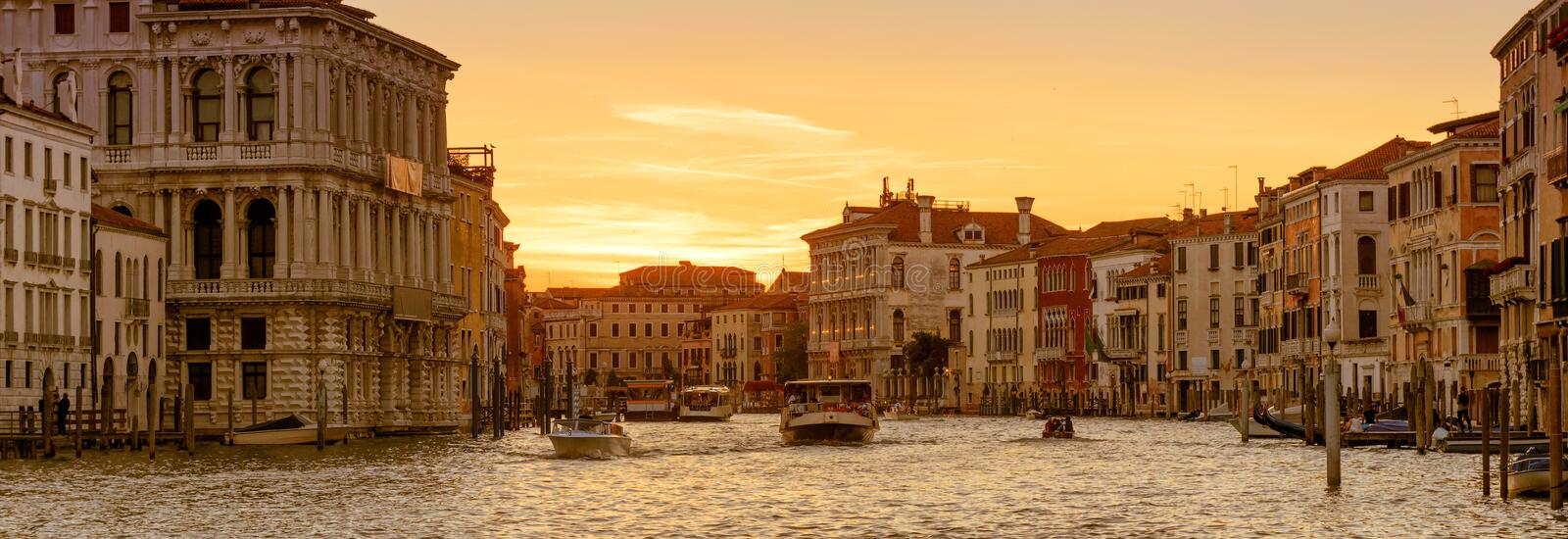 Panoramic view of Venice at sunset, Italy. Horizontal banner of Venice for website header. Motor boats with tourists sail along the Grand Canal in Venice royalty free stock images