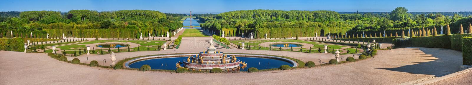 Panoramic view of the Versailles Park - the Latona Basin with the Grand Canal in the background. Under the summer sun, Versailles, France stock photos