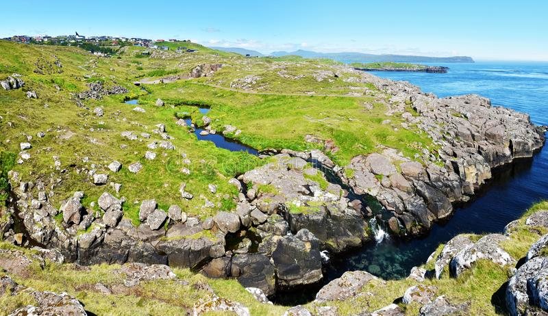 Panoramic View via Hoyvik from the costl. Panoramic View via Hoyvik agglomeration from Hoydalsa river course joining ocean waters in Faroese island of Streymoy stock photos