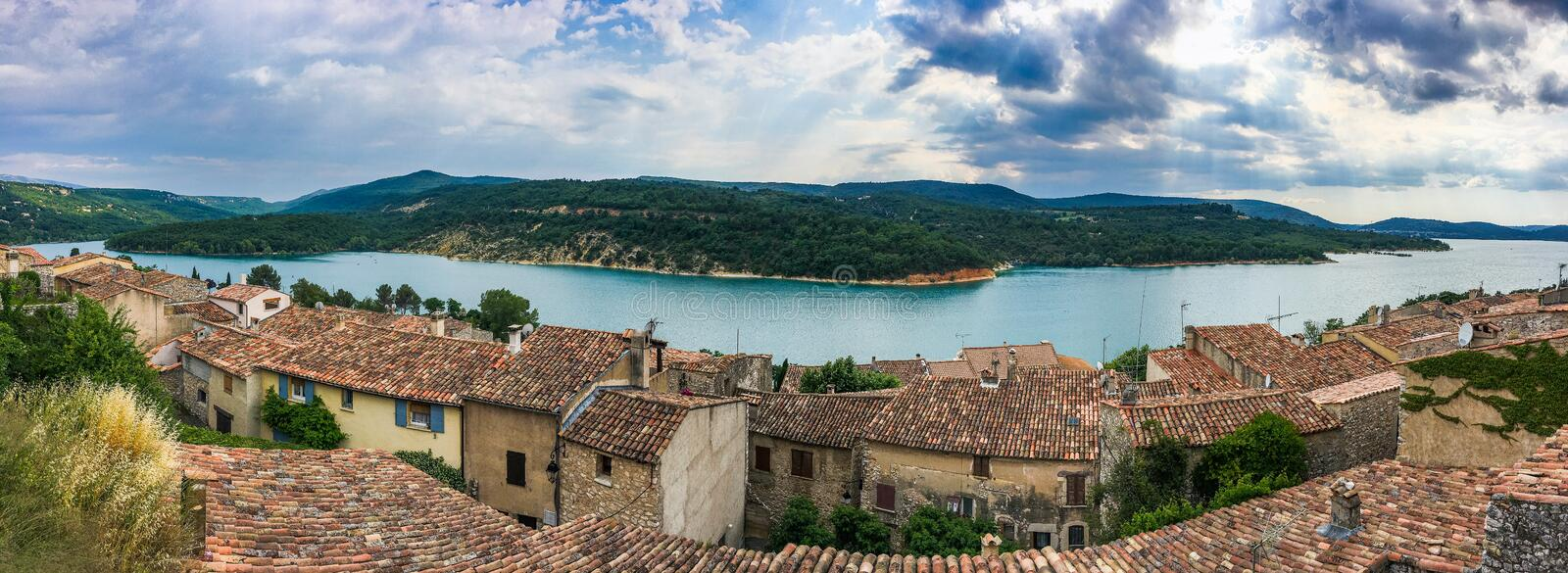 Panoramic view of village Bauduen, France on lake Sainte Croix. Panoramic view of old village Bauduen, France on lake Sainte Croix royalty free stock photography