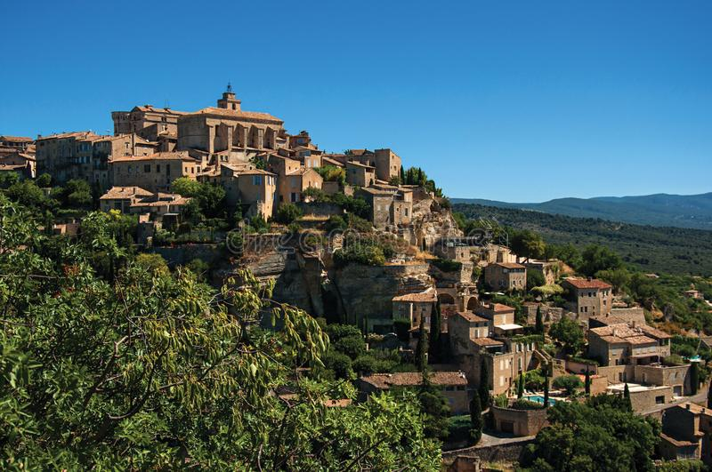 Panoramic view of the village of Gordes on top of a hill. And under sunny blue sky. Located in the Vaucluse department, Provence region, in southeastern France royalty free stock photo