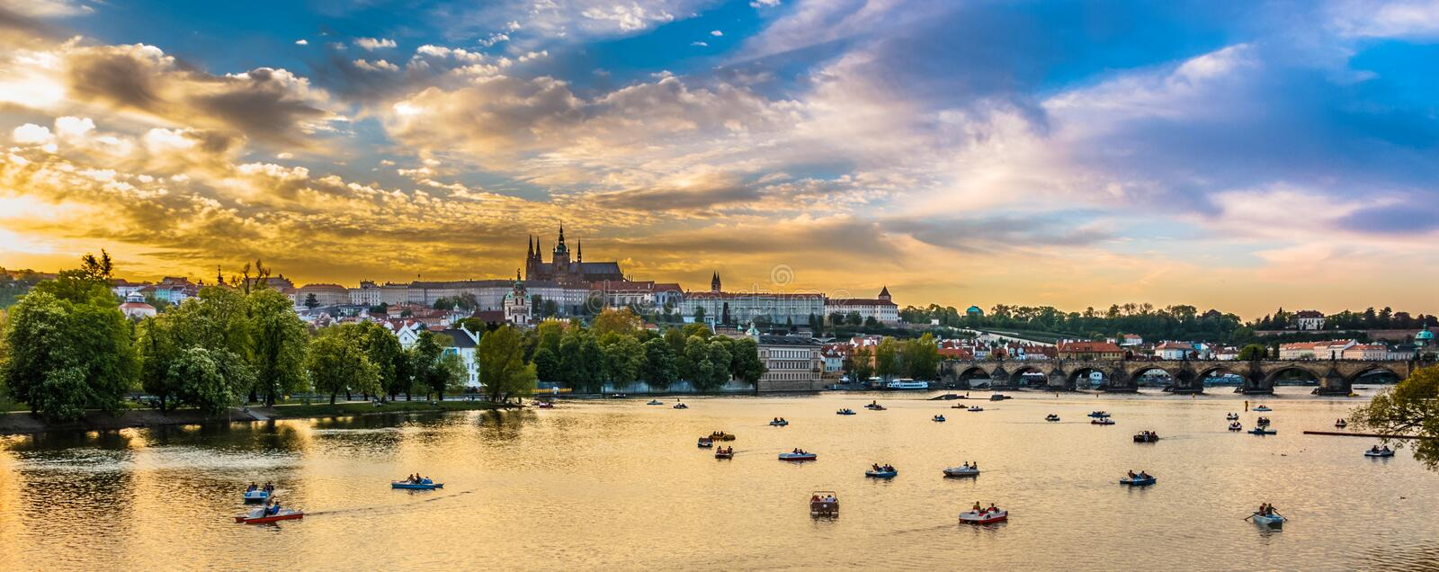 Panoramic view of Vltava river with boats, Prague, Czech Republic. Panoramic view of Vltava river in sunset with boats, Prague, Czech Republic, 2016 stock photo