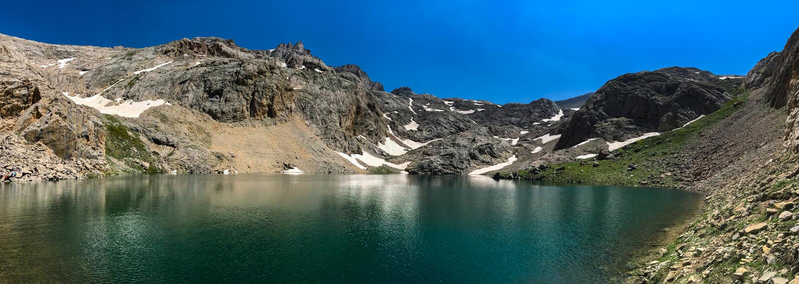 Panoramic view of volcanic crater lake between Bolkar Mountain and Taurus Mountain, Nigde, Turkey. It is known ` `black lake stock photography