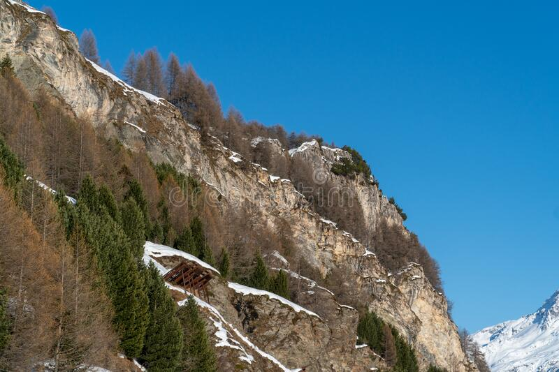 Panoramic view on winter snowy mountains at nice sunny evening royalty free stock photo