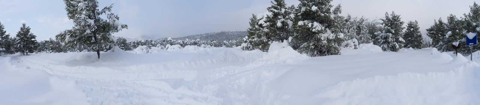 Panoramic view Wonderful winter with lots of snow and snow drifts in a Greek village on the island of Evia, Greece royalty free stock images