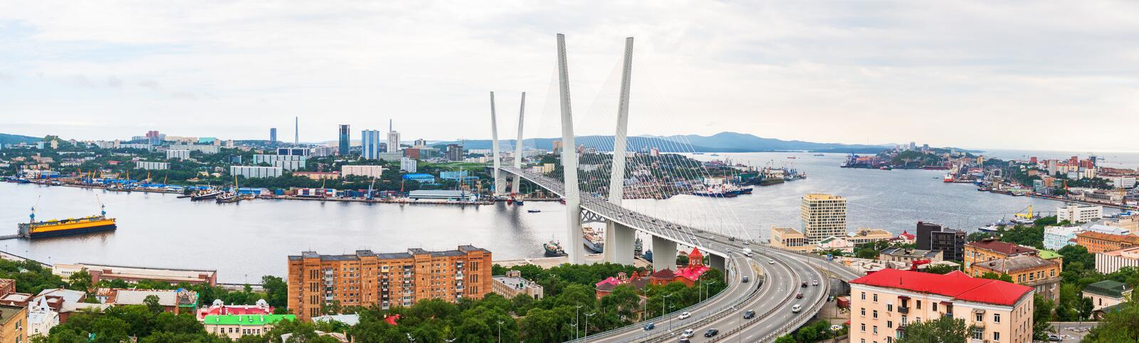 Panoramic view on the Zolotoy Golden Bridge is cable-stayed bridge across the Zolotoy Rog or Golden Horn in Vladivostok stock photo
