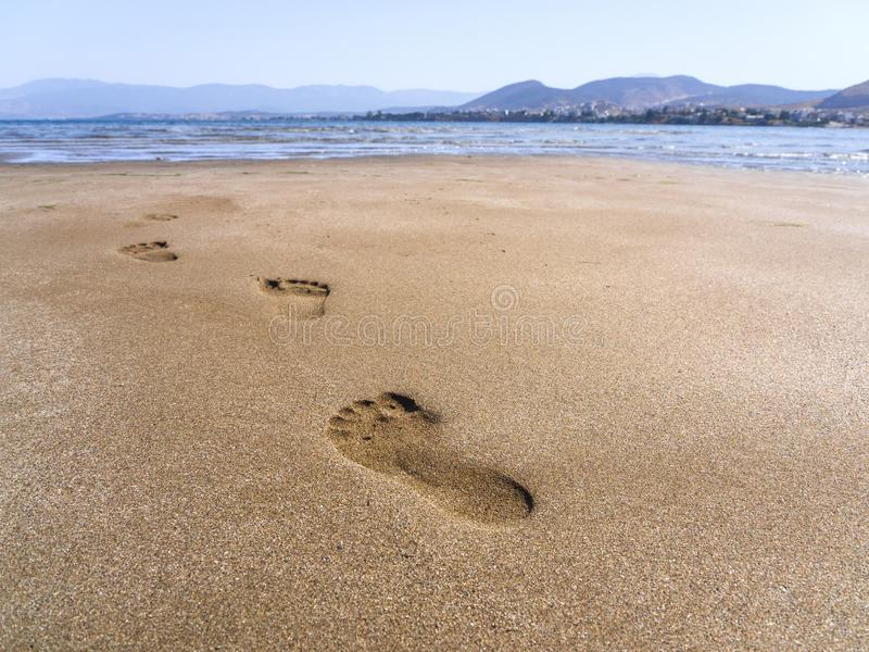 Panoramic views of the sandy beach, the mountains and footprints in the sand at low tide on Liani Ammos beach in Halkida, Greece o. Panoramic views of the sandy royalty free stock photo