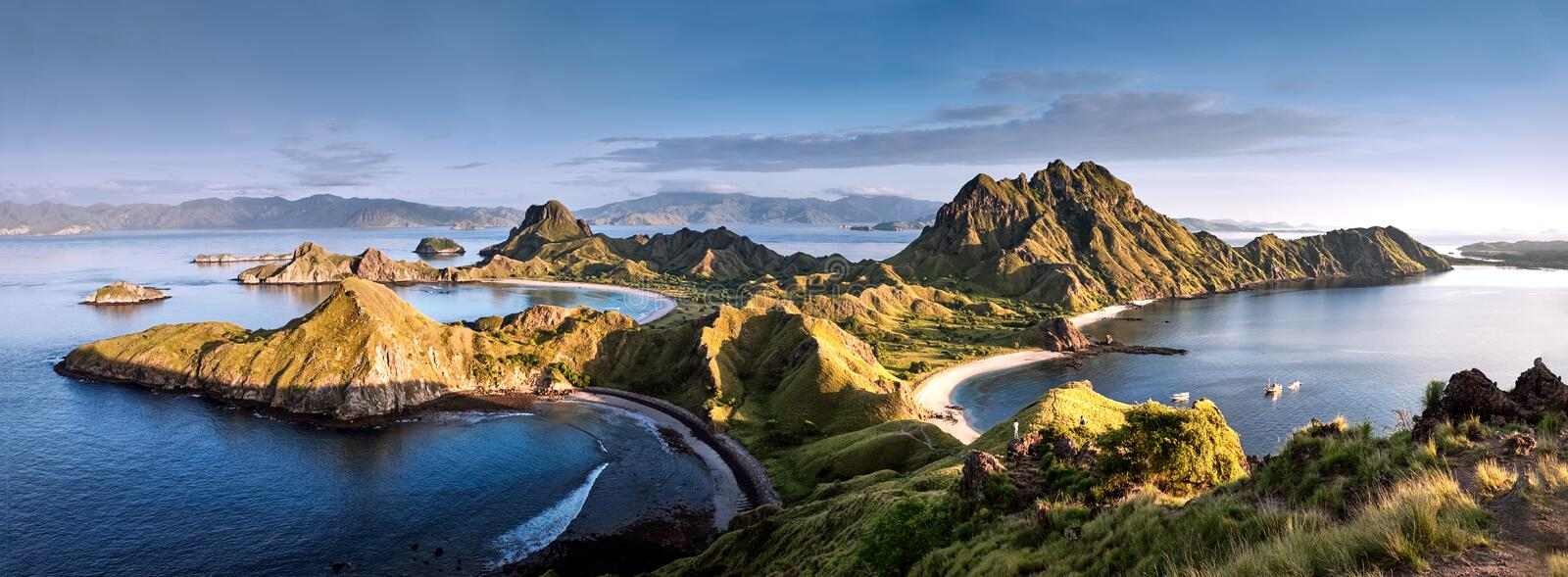 Panoramic warm view at top of `Padar Island` in sunrise late morning from Komodo Island, Komodo National Park, Labuan Bajo, Flor. Es, Indonesia. in summer royalty free stock photo